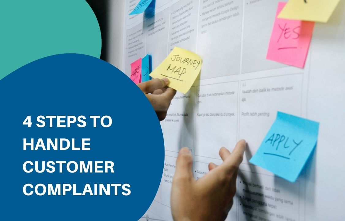 sticky notes about handling customer complaints on a white board