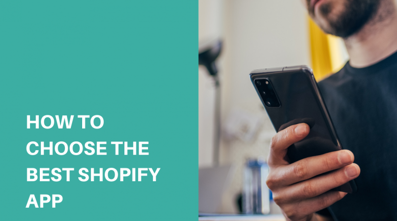 man in black shirt holding a black iphone installing the best shopify app