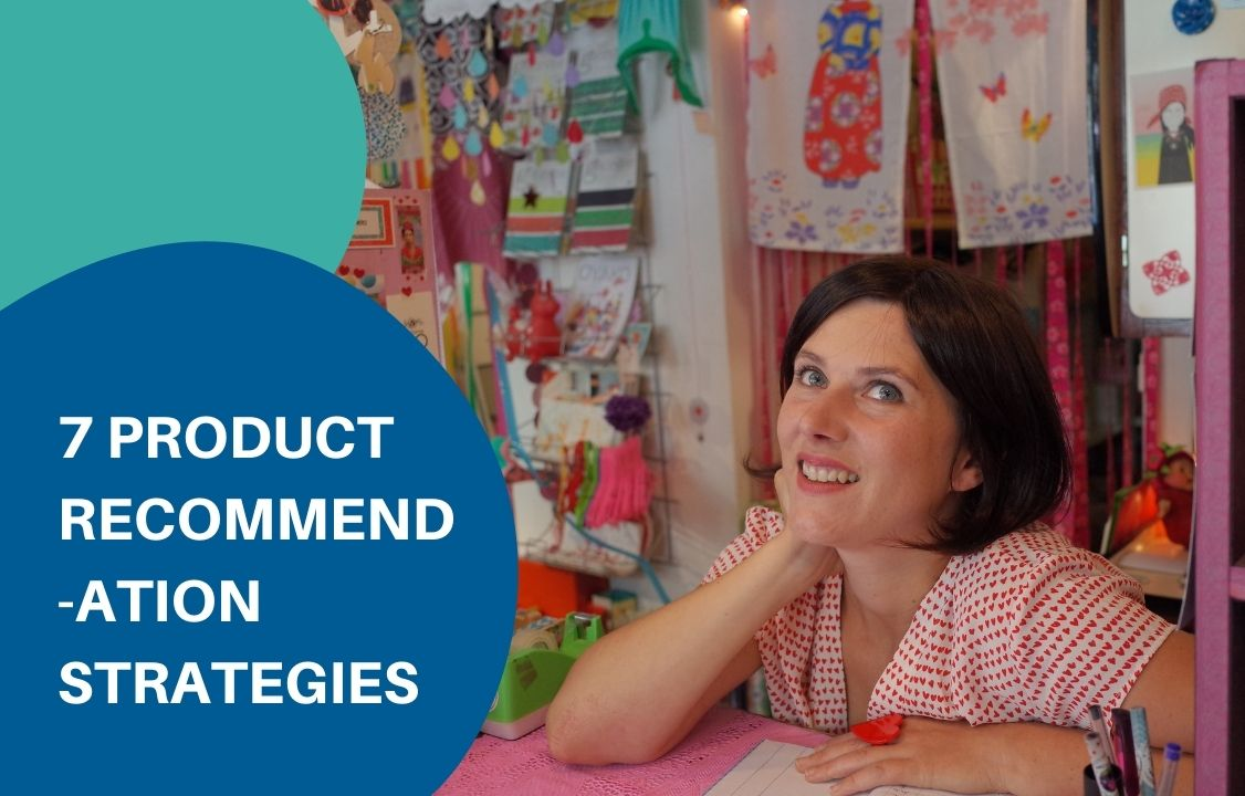 a woman leaning on the pink desk talking about product recommendation